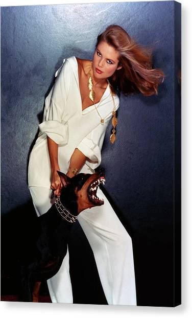 Doberman Pinschers Canvas Print - Christie Brinkley Wearing Geoffrey Beene Pajamas by Chris Von Wangenheim