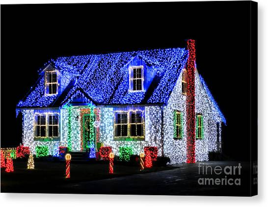 Christmas Lights Canvas Print - Christmas Lighthouse by Olivier Le Queinec