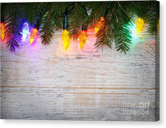 Christmas Lights Canvas Print - Christmas Lights With Pine Branches by Elena Elisseeva