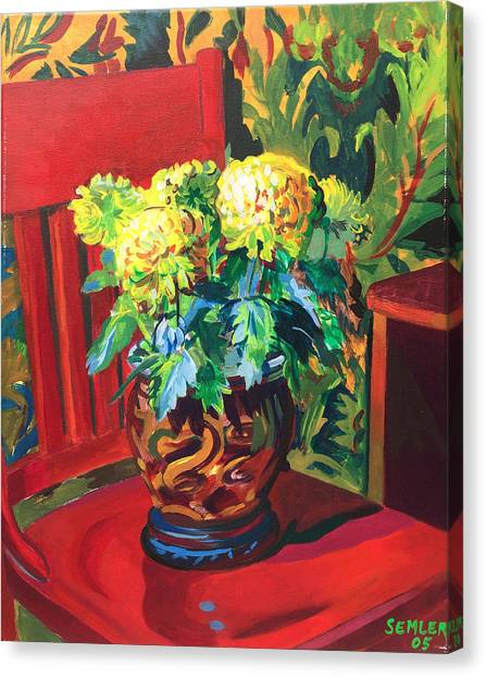 Chrysanthemums On Red Chair Canvas Print