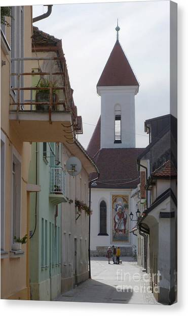 Church And Houses - Kranj - Slovenia Canvas Print by Phil Banks