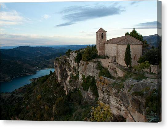 Church On Cliff By River Canvas Print by David Oliete