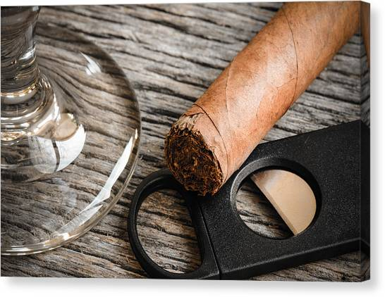 Cigar And Cutter With Glass Of Brandy Or Whiskey On Wooden Backg Canvas Print