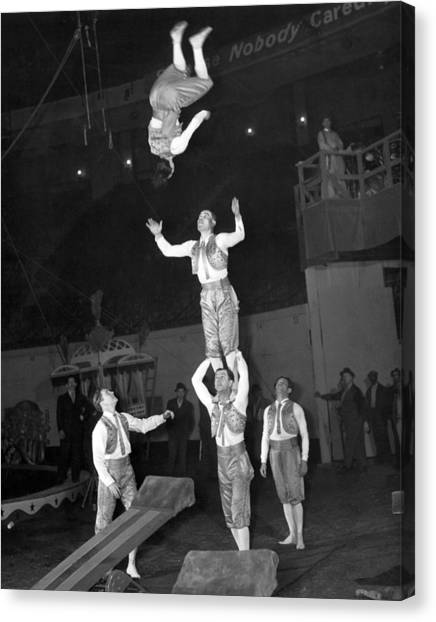 Acrobatic Canvas Print - Circus Acrobats Practicing by Underwood Archives
