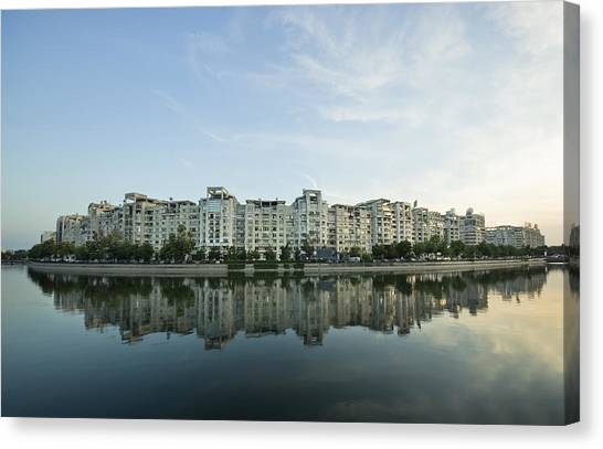 City And Water Canvas Print by Ioan Panaite