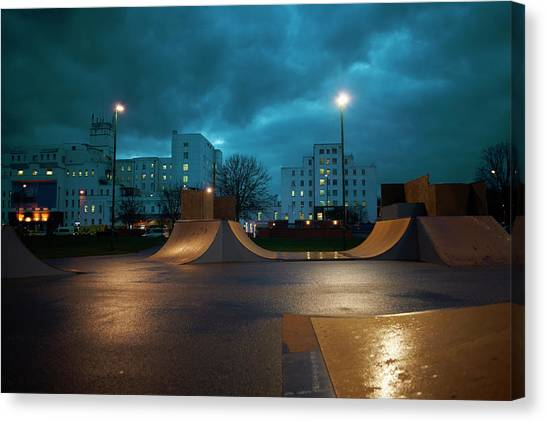 Cityscape And Skateboard Park At Night Canvas Print by Peter Muller