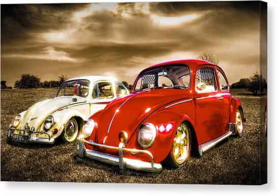Classic Vw Beetles Canvas Print by Ian Hufton