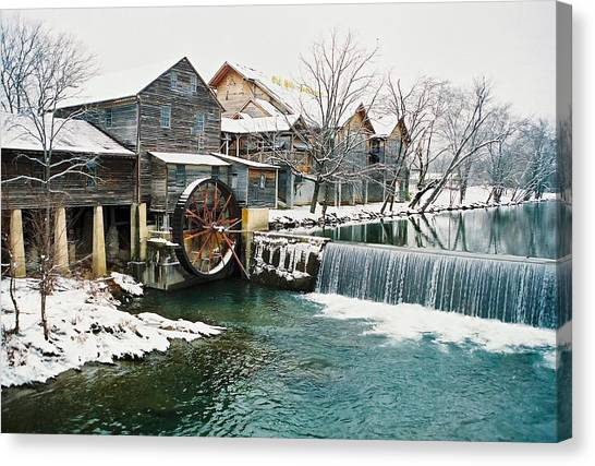 Clear Winter Day At The Old Mill Canvas Print by John Saunders