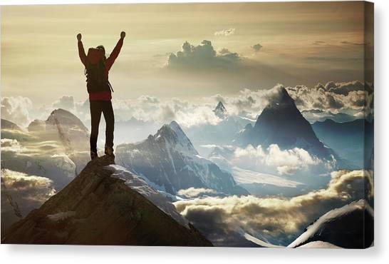 Climber Standing On A Mountain Summit Canvas Print by Buena Vista Images