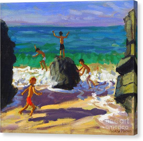 St Ives Canvas Print - Climbing Rocks Porthmeor Beach St Ives by Andrew Macara