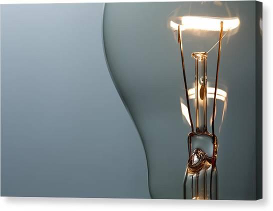 Close Up Glowing Light Bulb Canvas Print by Bernie_photo