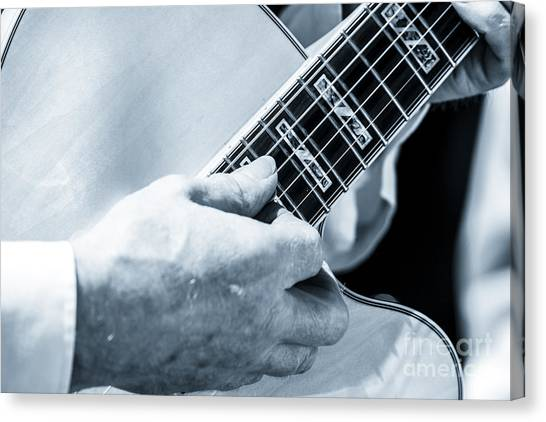 Close Up Of Guitarist Hand Strumming Canvas Print