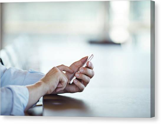 Close-up Of Hands Scrolling On Phone Canvas Print by Klaus Vedfelt
