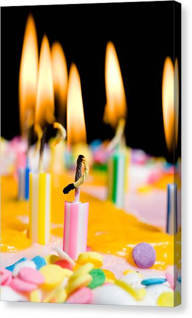close up of lit birthday candles photograph by joe belanger
