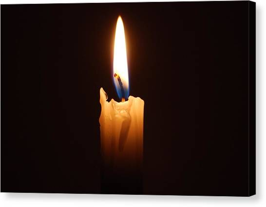 Close-up Of Lit Candle In Dark Room Canvas Print by Lau Vzquez / EyeEm