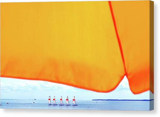 Close-up Of Parasol Against Boats On Sea Canvas Print
