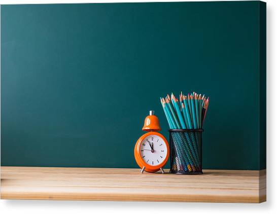 Close-up Of Pencils In Container By Alarm Clock On Table Canvas Print by Shih Wei Wang / EyeEm