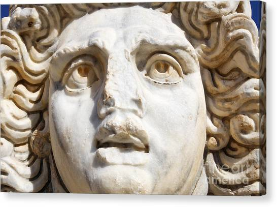 Gorgons Canvas Print - Close Up Of Sculpted Medusa Head At The Forum Of Severus At Leptis Magna In Libya by Robert Preston