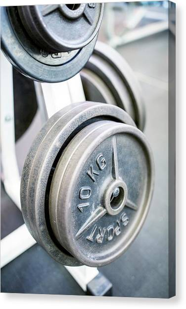 Close-up Of Weight Plates Canvas Print by Science Photo Library