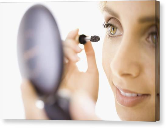 Close-up Of Woman Applying Makeup Canvas Print by Jupiterimages, Brand X Pictures
