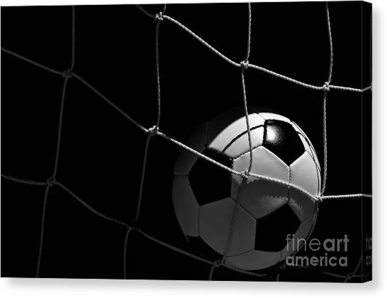 Closeup Of Soccer Ball In Goal Canvas Print