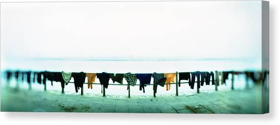 Ganges Canvas Print - Clothes Drying At The Riverbank, Ganges by Panoramic Images