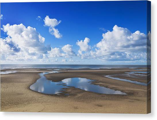 Clouds Across The Beach Canvas Print