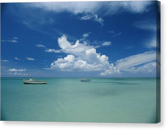 Clouds And Boats, Aruba Canvas Print by Skip Brown