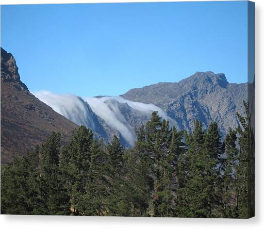 Clouds Flowing Over The Mountains Canvas Print