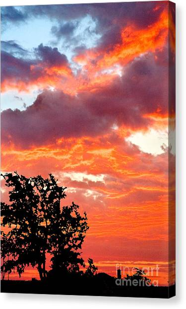 Canvas Print featuring the photograph Clouds On Fire by Mae Wertz
