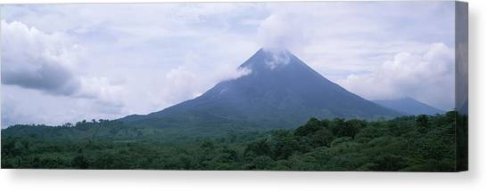 Arenal Volcano Canvas Print - Clouds Over A Mountain Peak, Arenal by Panoramic Images