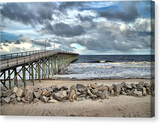 Clouds Over The Pier Canvas Print
