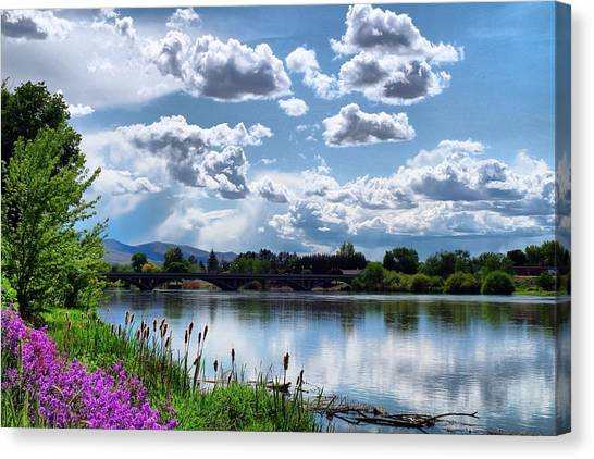 Clouds Over The River Canvas Print