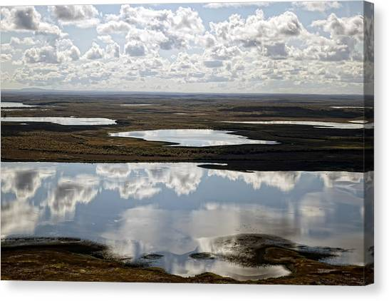 Clouds Reflected In Aleutian Lakes Canvas Print by Michael Riley