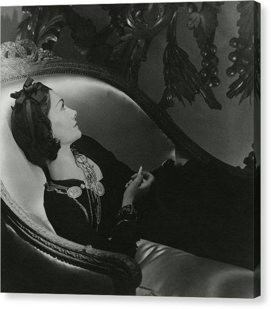 Coco Chanel On A Chaise Longue Canvas Print