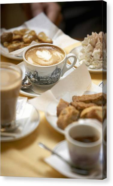 Coffee Drinks And Biscotti On Table In Cafe (focus On Cappuccino) Canvas Print by Bob Handelman