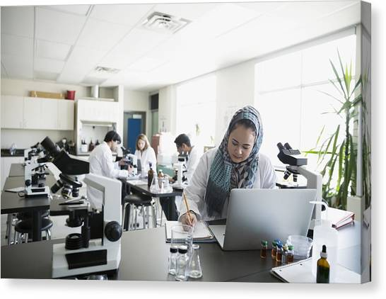 College Student Wearing Hijab At Laptop In Science Laboratory Canvas Print by Hero Images