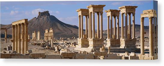 Syrian Canvas Print - Colonnades On An Arid Landscape by Panoramic Images