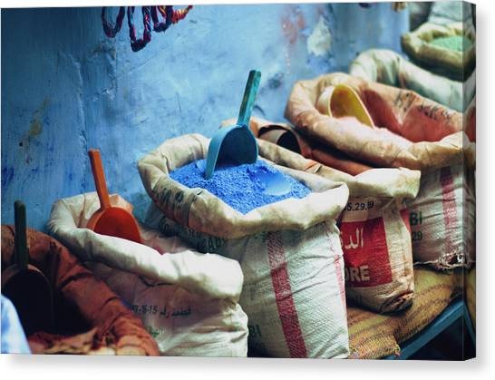Colored Powders For Textile Dyes On Canvas Print by Valeria Schettino