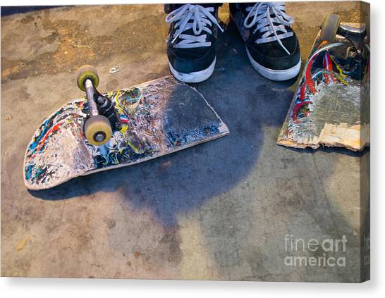 Colorful Busted Skateboard With Shoes  Canvas Print
