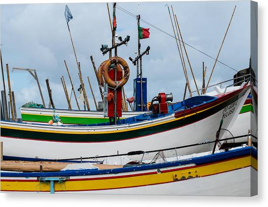 colorful fishing boat with Portuguese flag  Canvas Print