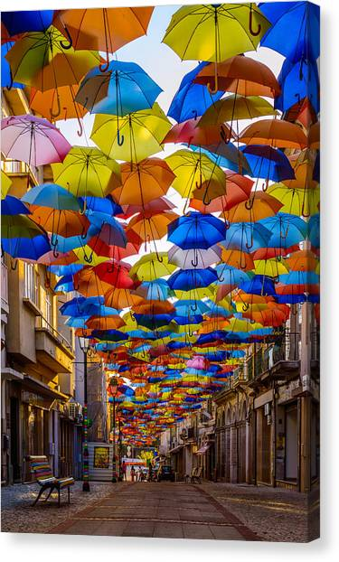 Installation Art Canvas Print - Colorful Floating Umbrellas by Marco Oliveira