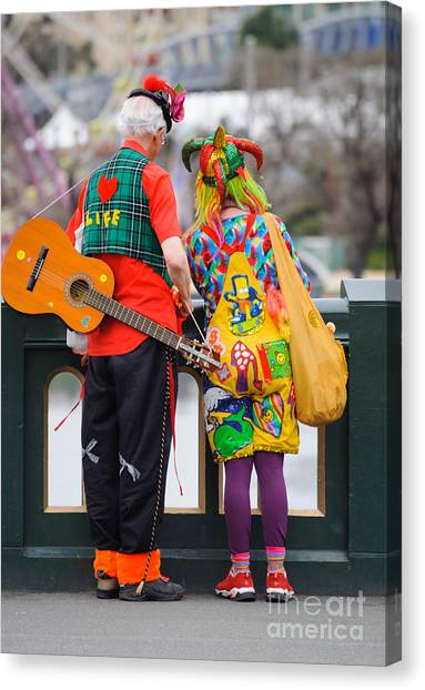 Colourfully Dressed Buskers Pause On The Way Home Canvas Print