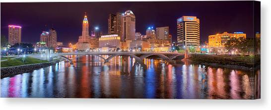 Evening Scenes Canvas Print - Columbus Skyline At Night Color Panorama Ohio by Jon Holiday