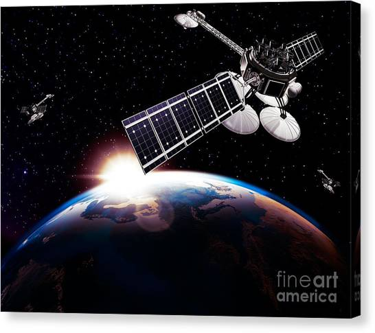 Comsats Canvas Print - Communication Satellites In Space Above Earth With Rising Sun by Oleksiy Maksymenko