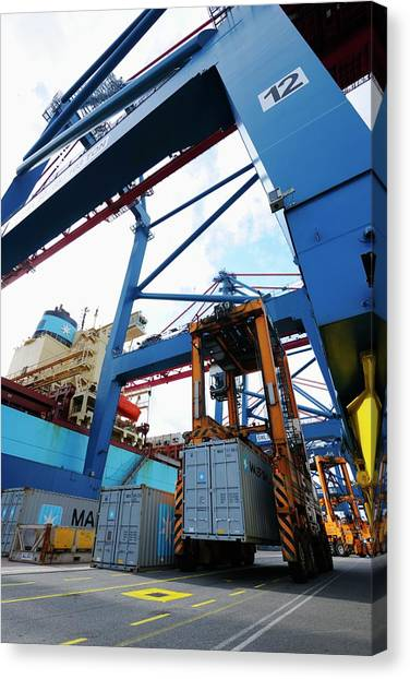 Forklifts Canvas Print - Container Crane Hoisting Cargo Onto Ship by Christian Lagerek/science Photo Library