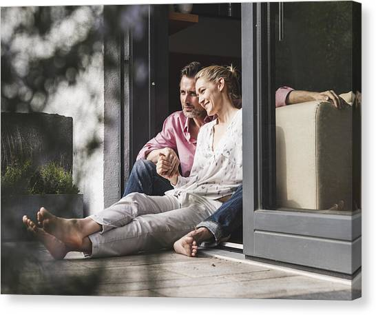 Content Mature Couple Relaxing Together At Open Terrace Door Canvas Print by Westend61