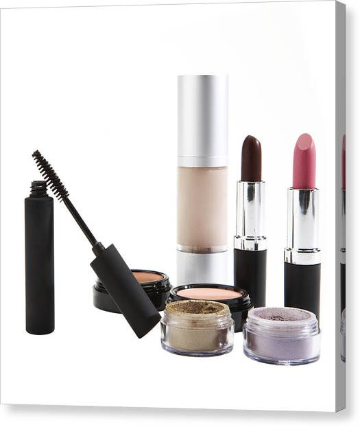 Cosmetics On White Background Canvas Print by Thomas Northcut