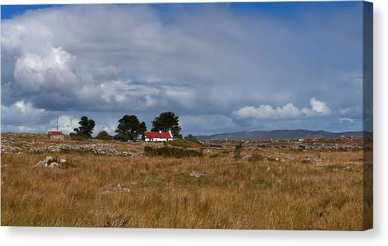 Moorland Canvas Print - Cottage And Rocky Barren Landscape by Panoramic Images