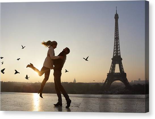 Couple Embracing, View Of Eiffel Tower Canvas Print by Peter Cade